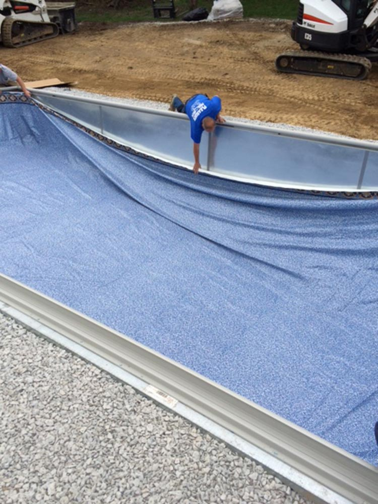 inground-pool-south-hills-pittsburgh-construction-placing-liner